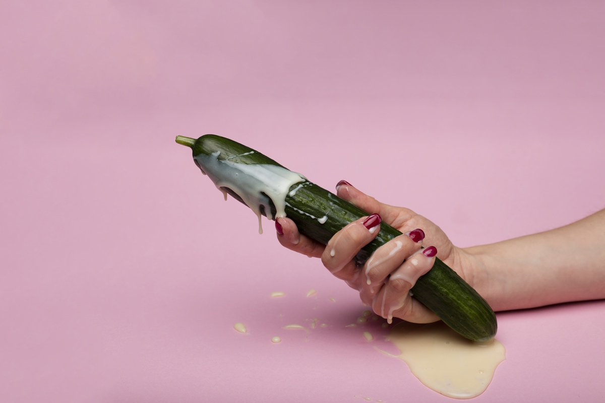 erotic photo hand holding cucumber