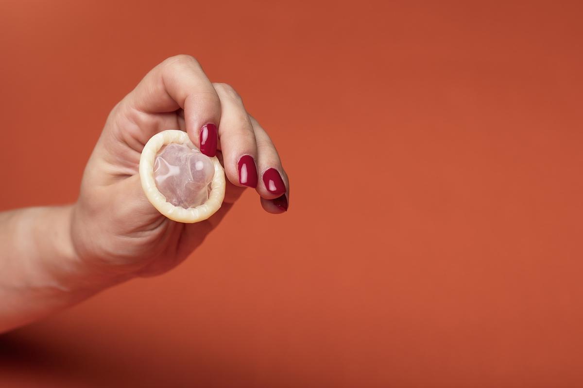 fingers condom holding free photo