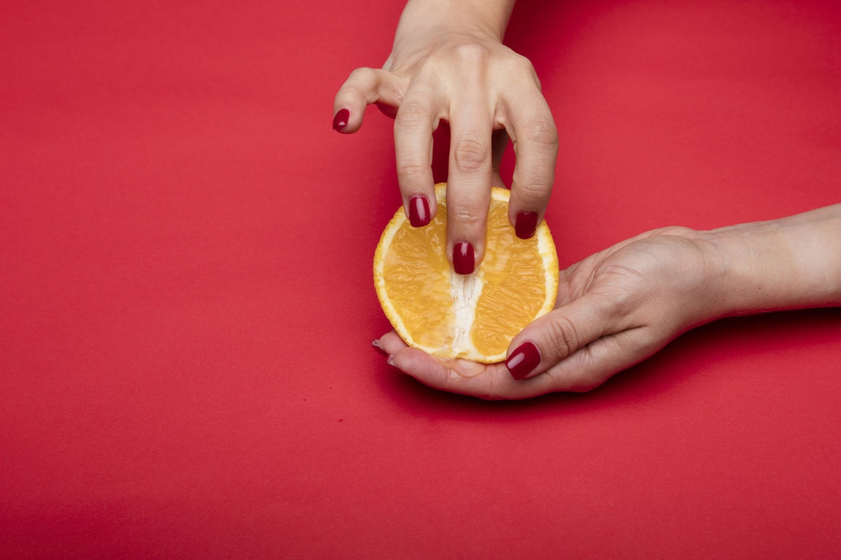 fingers in orange suggestive