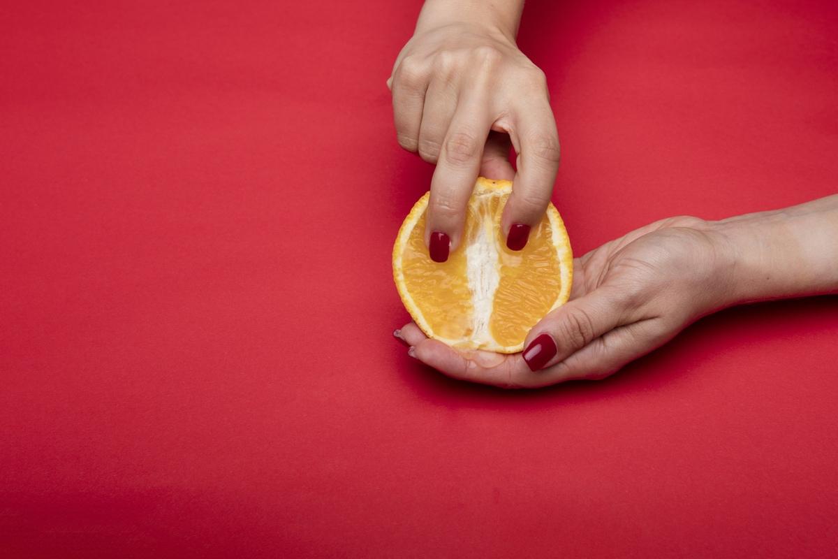 fingers inside fruit