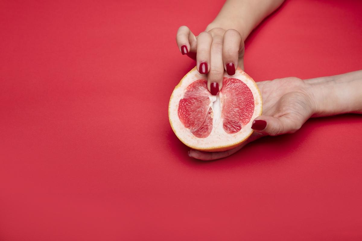 fingers touching grapefruit erotic photo