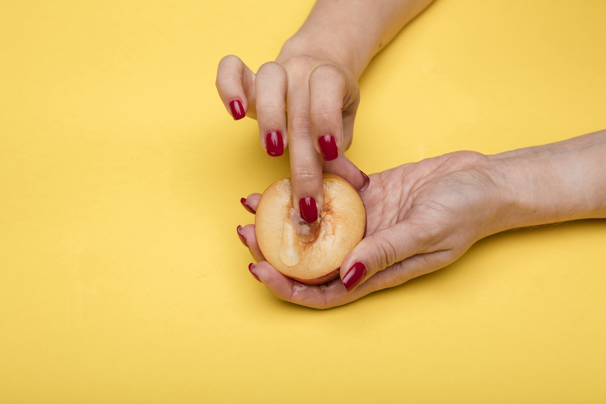 fingers touching peach
