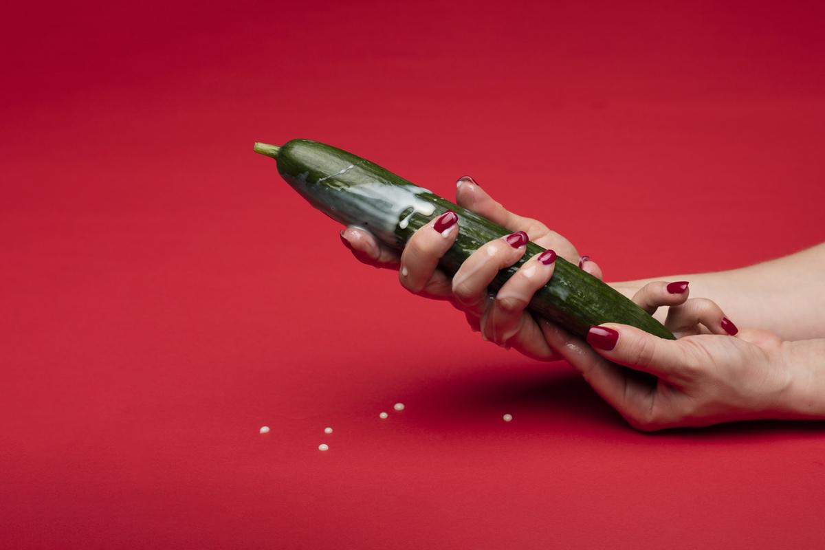 hand grabbing cucumber erotic